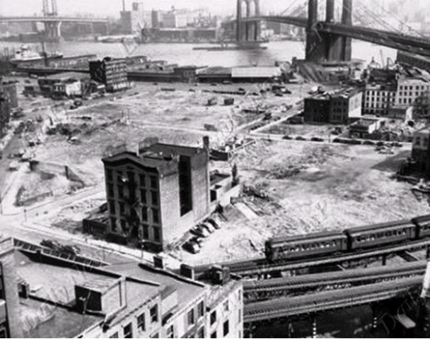 The old Oak Street station house of the Fourth Police Precinct was among the last structures to be removed when the Lower East Side neighborhood where cats once raided a butcher shop was demolished to make way for the Albert E. Smith housing project. This photo was taken around 1950.