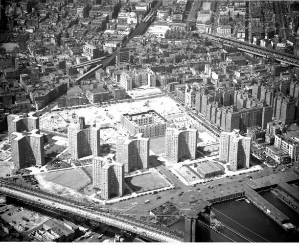 Construction of the Alfred E. Smith Houses began in 1950 and was completed in 1953. The butcher shop at 70 James Street was right about in the center of this photo, where the large square building is going up.