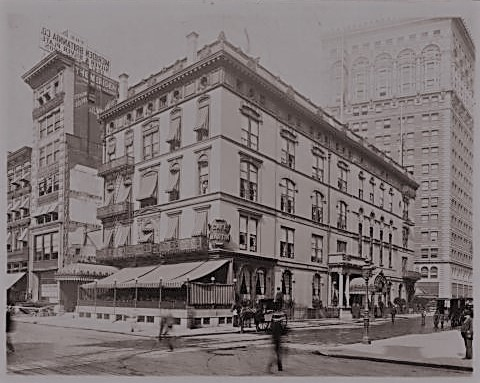 In 1902 when this photo was taken, the Cafe Martin was leasing the building that was home to Delmonico's restaurant from 1876 to 1899. The Town Topics office is to the far left. Museum of the City of New York Collections