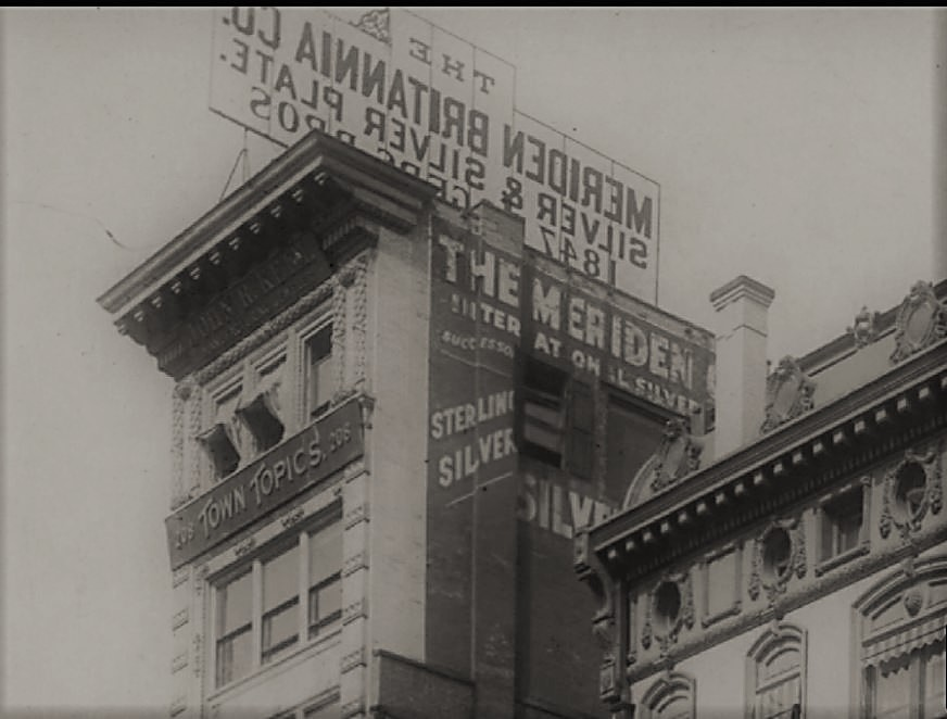 In this closeup of the top floors of 208 Fifth Avenue, you can see the marquee for Town Topics and the windows from which The Laird and Little Billee made their fatal leaps to the pavement below.