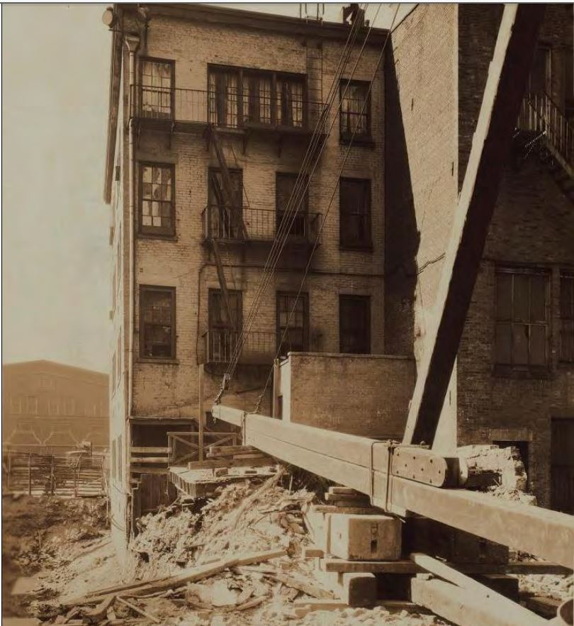 In 1925, the Bowling Green Community Playground adjacent to 45 West Street was demolished to make way for commercial development. This photo from 1925 shows the rear of 45 West Street with new construction in progress.