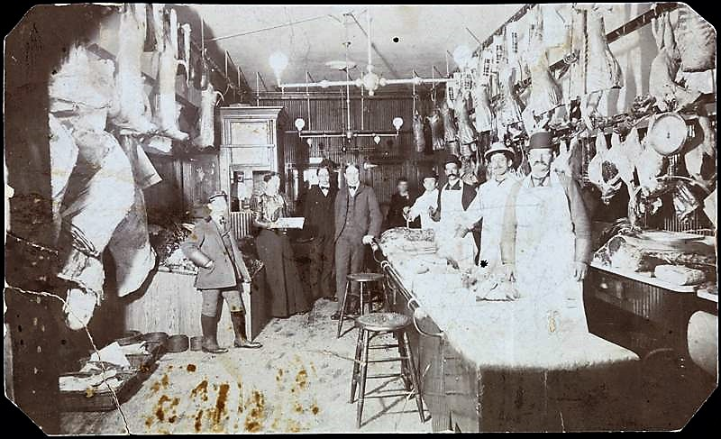 A butcher shop like this one, pictured in 1899, must have been the fantasy of all the starving street cats. Being tossed into a shop filled with meat was no doubt a dream come true for the cats on James Street.