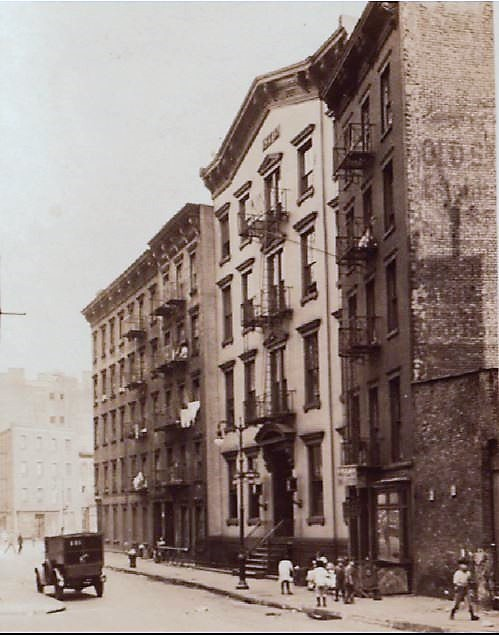 The sound of the explosion was heard at the 4th Precinct police station at 9 Oak Street, pictured here (middle) in 1927. The police station was two blocks from the butcher shop.