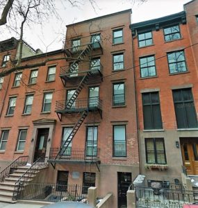 The four-story, nine-unit apartment building at 308 Hicks Street was constructed in 1899. Today, developers have proposed converting the building into a luxury single-family townhouse.