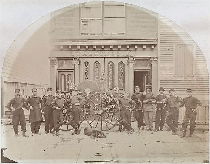 Organized in 1785, Brooklyn's first volunteer fire company, Washington Engine 1, was headquartered at Fulton and Front Streets. This photo of the firemen and their dog was taken 100 years later, in 1880.