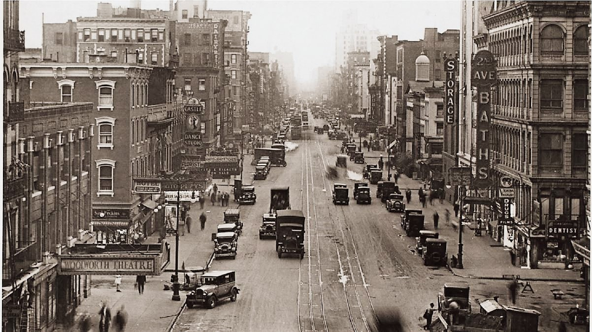 In this view of Second Avenue looking north from East 1st Street, the photo plays theater is visible on the left, a couple of buildings north of the Woolworth Theatre. New York Public Library Digital Collection